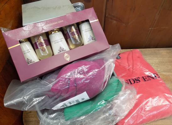Box of jumpers and cosmetics