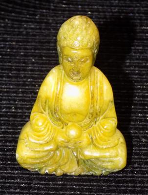 Miniature green stone Buddhist figure (60mm high)