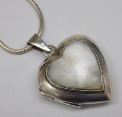 Silver mother of pearl locket on silver snake chain