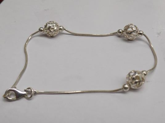 "Unusual silver bracelet, approx. 7.5"" long"