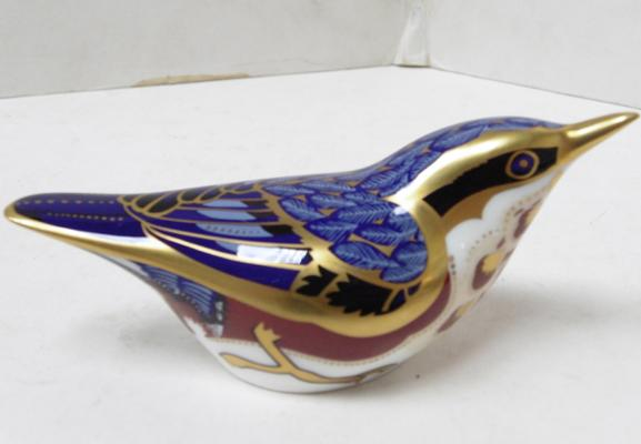 R.C.D. Nuthatch paperweight, gold stopper