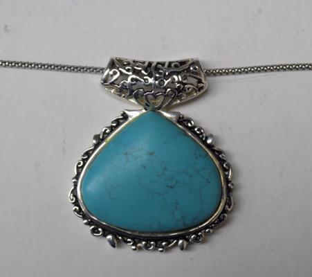 Silver and turquoise pendant on silver chain