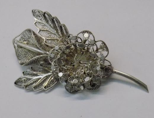 Detailed filigree brooch