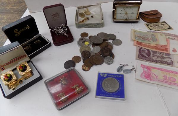 Box of mixed coins, banknotes, cuff-links and travel clock