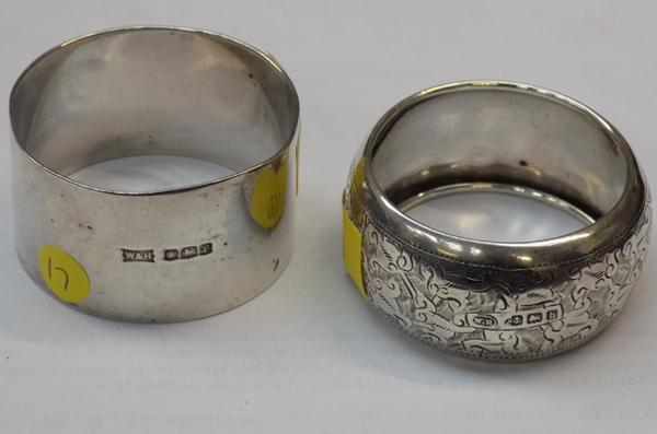 Two early Walker & Hall solid silver napkin rings, Birmingham 1907, Sheffield 1923