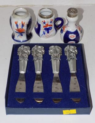 Selection of silver topped condiments + four knives
