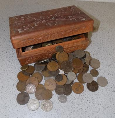 Vintage carved box full of coins