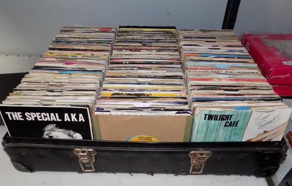 "Large box of 7"" records in DJ tray"