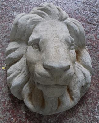 Lion mask in stone