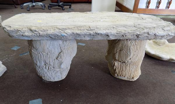 Timber seat in stone - on stone log plinths