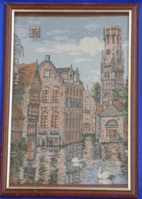 Framed tapestry of buildings & swans on river