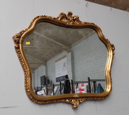 Ornate gilt framed mirror