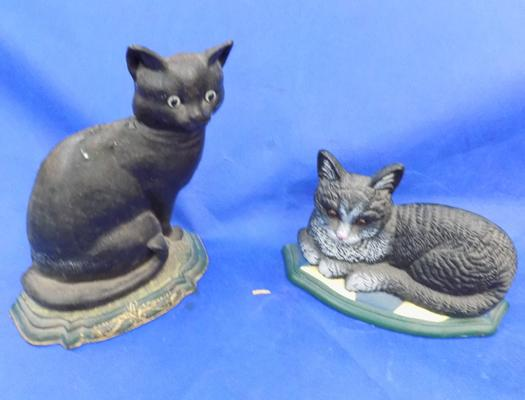 Two cast iron figures of cats