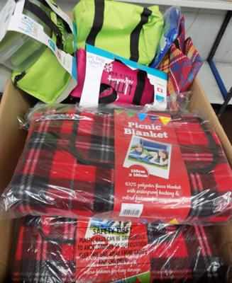 Box of picnic blankets and bags