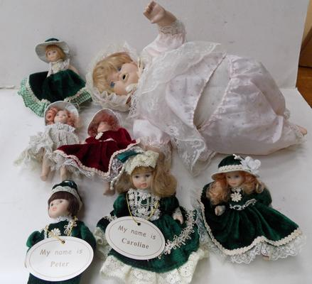 6 small porcelain dolls and one large