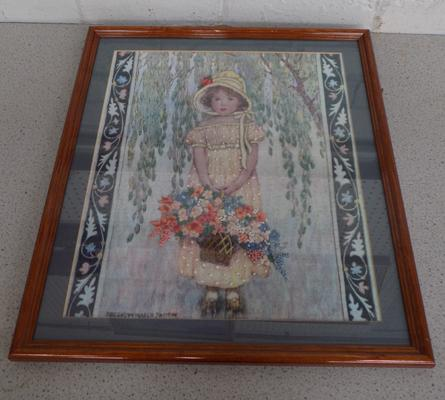 Framed embroidery of girl with flowers
