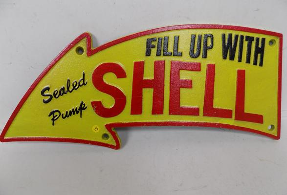 Cast iron arrow shell sign