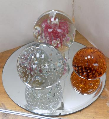Three paperweights + glass stand