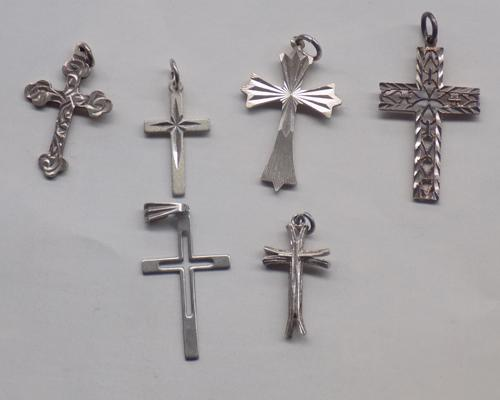 Six silver crosses