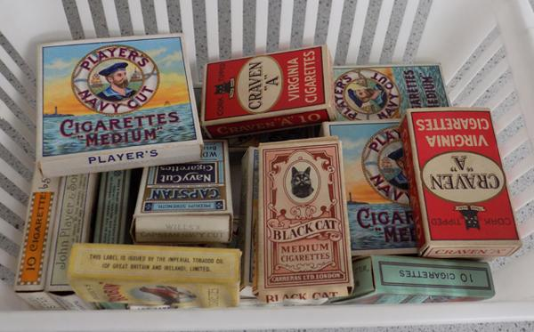 Box of vintage cigarette boxes