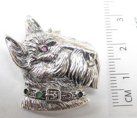 Silver dog brooch with ruby eye, emerald collar