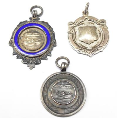 Three silver fob medals, dated 1952, 1953 & 1956-57, hallmarked Birmingham