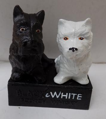 Black and white whiskey doorstop