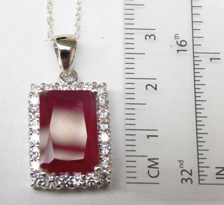 Silver & ruby pendant on silver chain