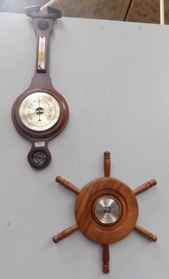 2 barometers (1 at fault and 1 in shape of a ship wheel)