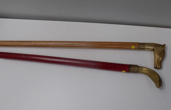 Two vintage walking sticks with brass heads