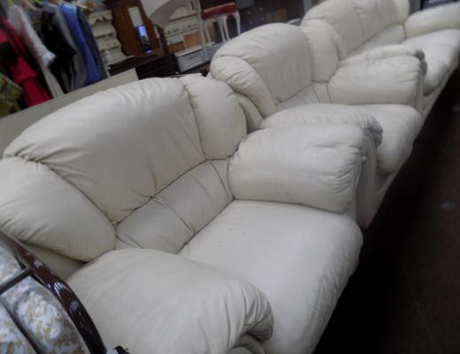 Three seater Italian cream leather settee and two chairs