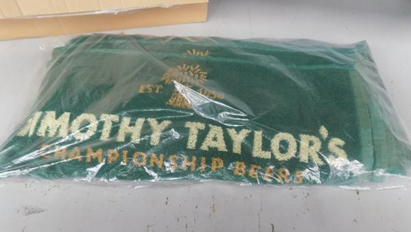 Sealed pack of 10 Timothy Taylor beer towels