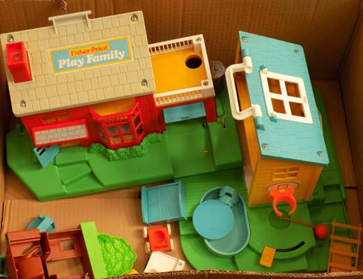 Box of Fisher Price play family