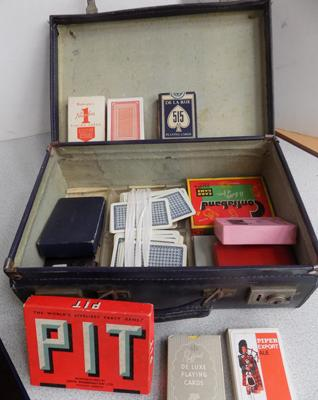 Small vintage suitcase with vintage playing cards