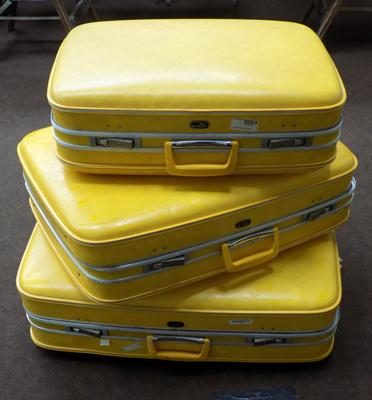 Set of 3 vintage crown suitcases in yellow