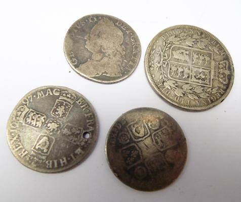 Four silver coins, 1883, 1697 plus two others, date rubbed off