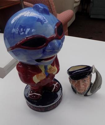 Planet Hollywood character and Doulton jug