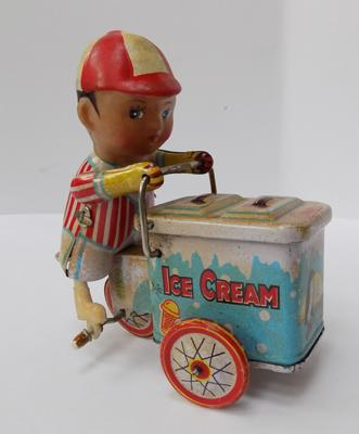 1930's Wells Brim toy tinplate clockwork ice cream seller with ice cream barrow