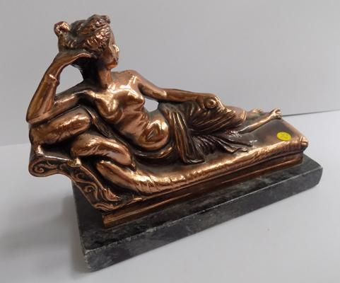 Copper figure on marble plinth
