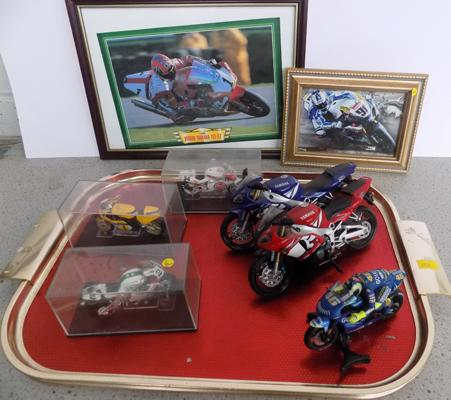 Tray of model motorbikes, with two motorbike pictures