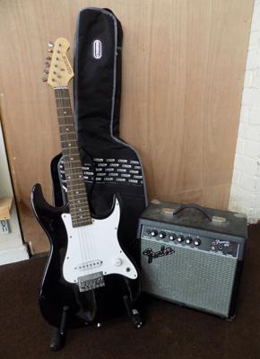Electric guitar, case and fender amplifier