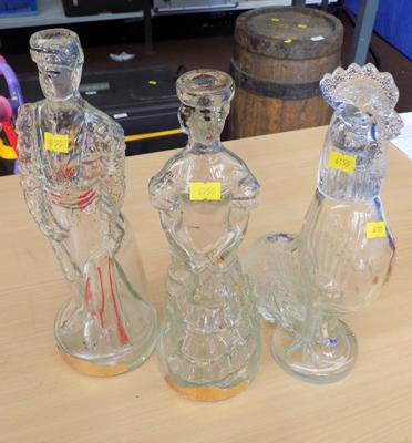 Three glass bottle figures