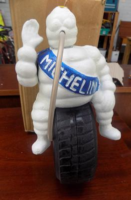 Cast iron Michelin Man, sitting on tyre - 24cm tall
