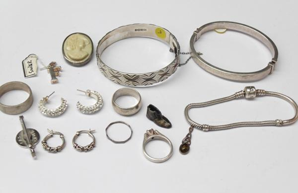 Selection of silver items, rings, earrings, charms, brooch & some scrap