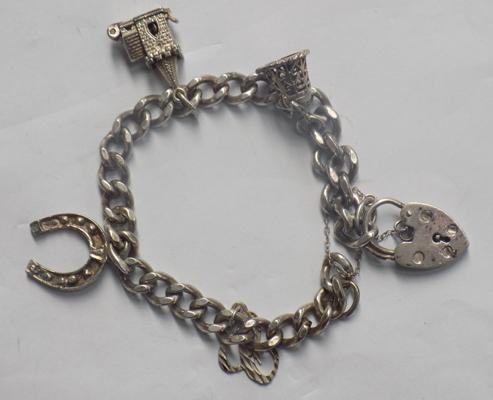 Charm bracelet 925 fully hallmarked with 5 charms