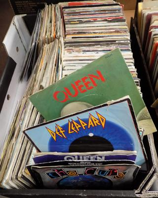 Approx. 230 Rock & some Pop singles, incl. Queen, Hawkwind, Def Leppard, Free, Springsteen etc...