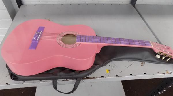 Child's pink acoustic guitar
