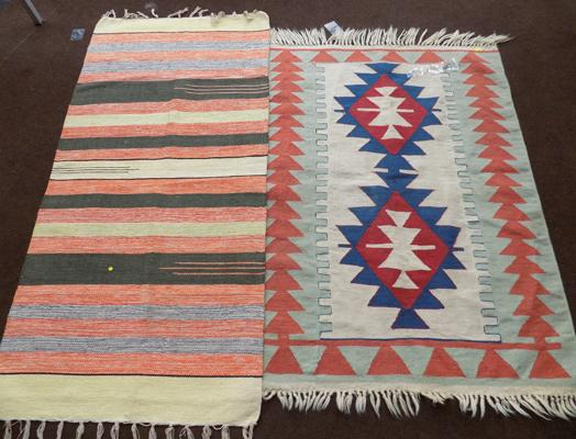 Two woven rugs - 1 damaged