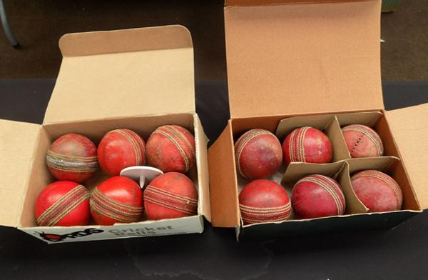 Two boxes of cricket balls