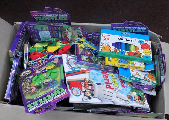 Box of new kids items including Mr Men, TMNT shell shooters